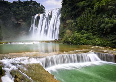 ☎重庆到贵州黄果树瀑布、南江大峡谷双卧四日旅游报价【往返双卧】